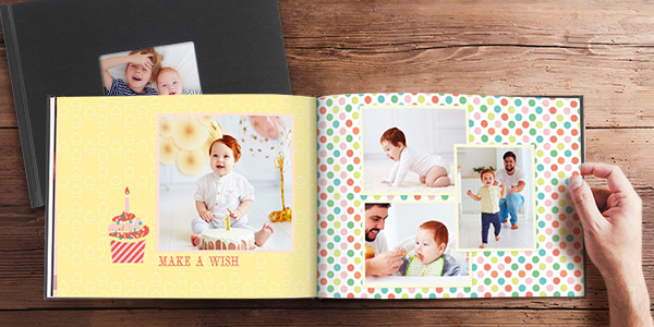 Photo book showing baby's first birthday